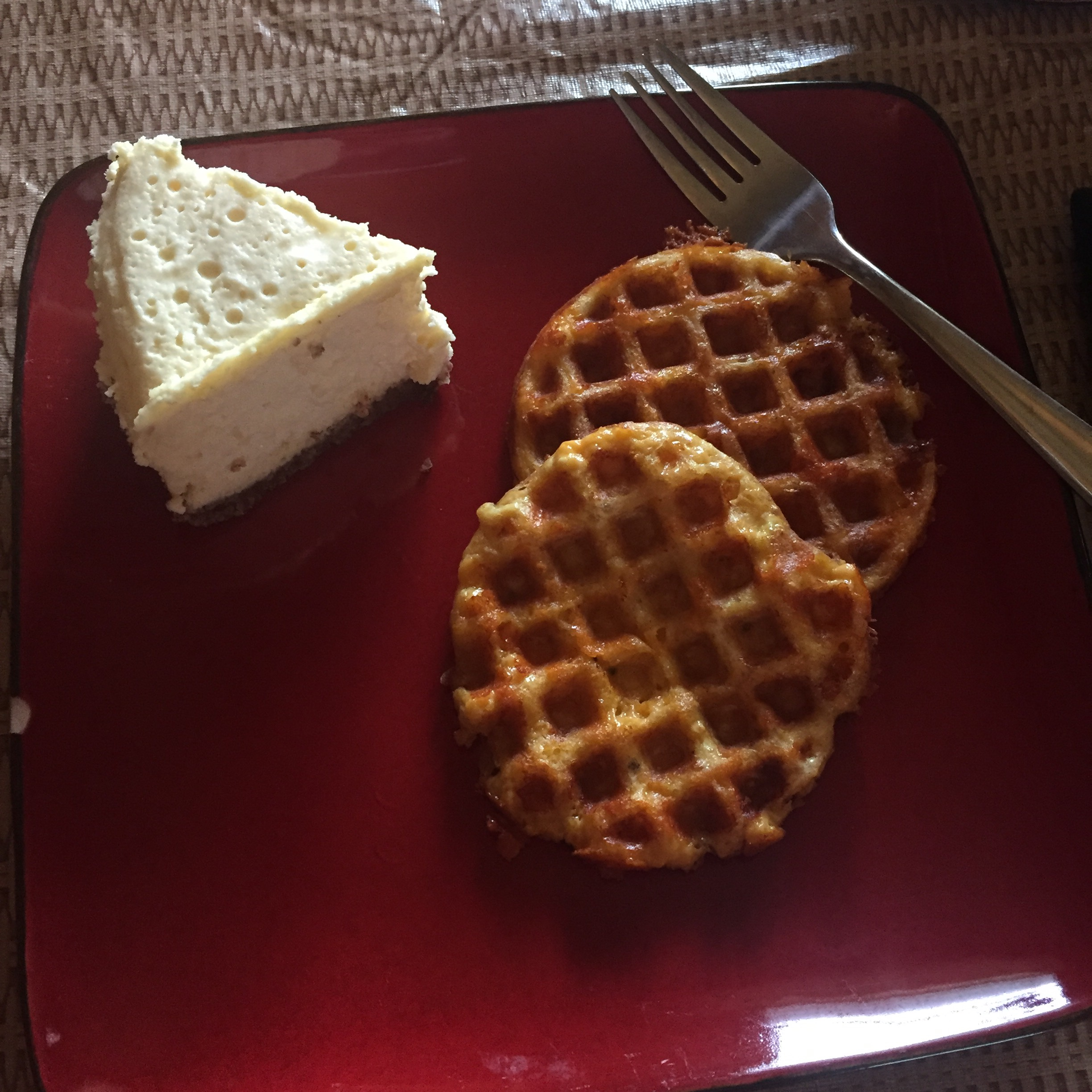 Chaffles and cheesecake on square red plate